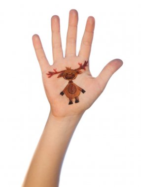 Children's hands raising up with painted Christmas symbols:  rain deer,