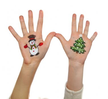 Children's hands raising up with painted Christmas symbols: Christmas tree, Snow man