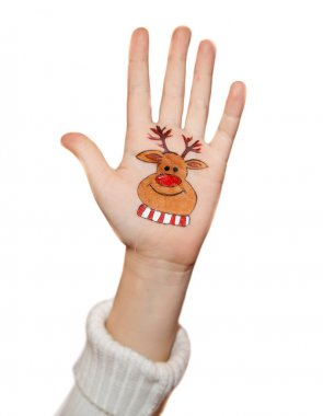 Children's hands raising up with painted Christmas symbols: Santa Claus, Christmas tree, Snow man, rain deer, present box