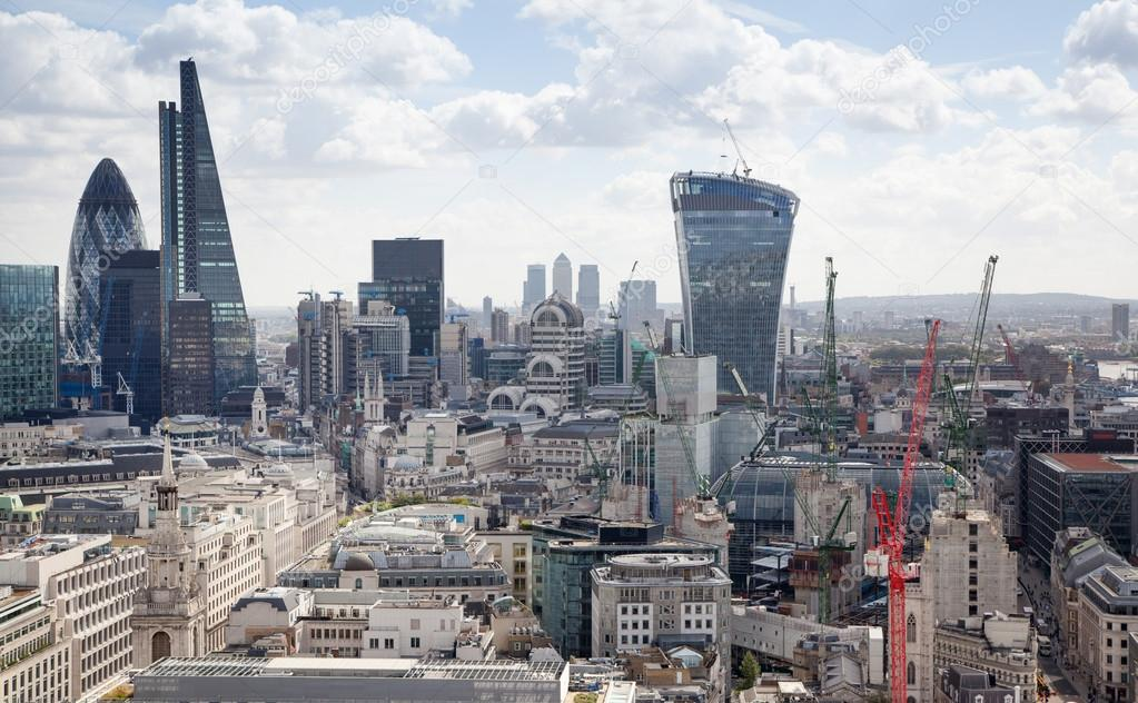 LONDON, UK - AUGUST 9, 2014 London view. City of London one of the leading centres of global finance this view includes Tower 42, Lloyds bank, Gherkin building and other