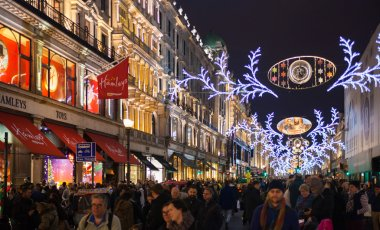 LONDON, UK - NOVEMBER 30, 2014: Black Friday weekend in London the first sale before Christmas. Regent street beautifully decorated with Christmas lights. Roads were open for pedestrians only