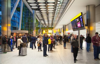 LONDON, UK -  MARCH 28, 2015: Inside Heathrow Airport Terminal 5. International arrivals. People waiting to pick up travellers