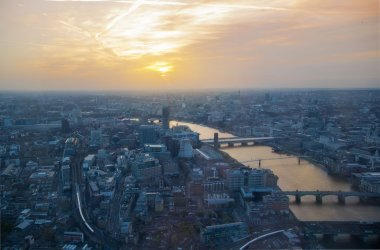 London sunset view from the Shard. Centre of London, London eye, River Thames with beautiful light reflection.