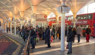 LONDON, UK - NOVEMBER 29, 2014: Stratford international. Central bus stop with commuters