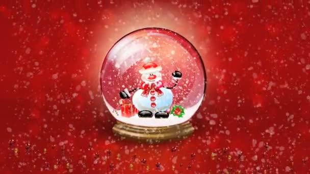 Vánoční pozadí. Animovaná ukázka sněhulák happy mávat ve sněhové koule. Sněhová koule Crystal proti červeným pozadím a padající sníh