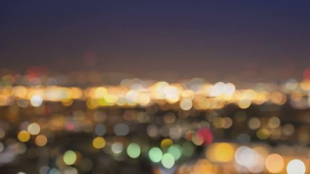 City lights blur at night. London