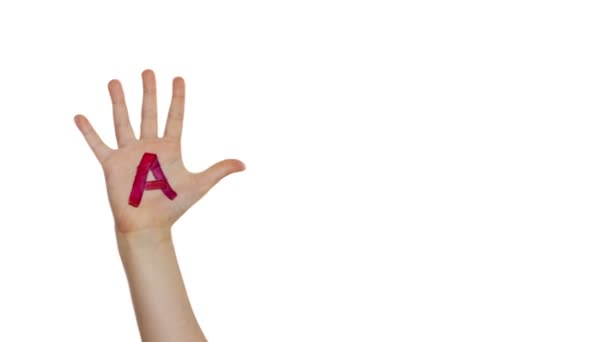 ABC alphabet letters painted on children hands. School and learning concept