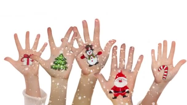 Childrens hands raising up with painted Christmas symbols: Santa Claus, Christmas tree, Snow man,  present box