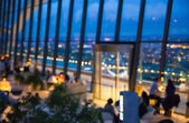 Londons night life. People in restaurant, night lights blur