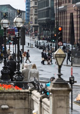 LONDON, UK - SEPTEMBER 17, 2015: City of London. Bank of England square view after the rain with lots of people