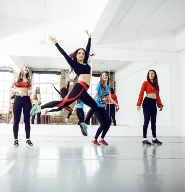 Women doing sport in gym, healthcare lifestyle people concept, modern loft studio