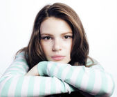 Fotografia Teenage Girl Looking Worried isolated on white background