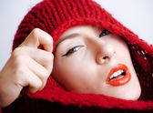 young pretty woman in sweater and scarf all over her face, winter cold close up, lifestyle people concept