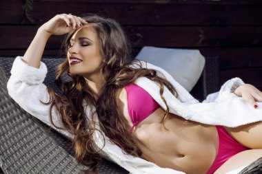 beauty young woman after spa in bikini and robe at hotel resort