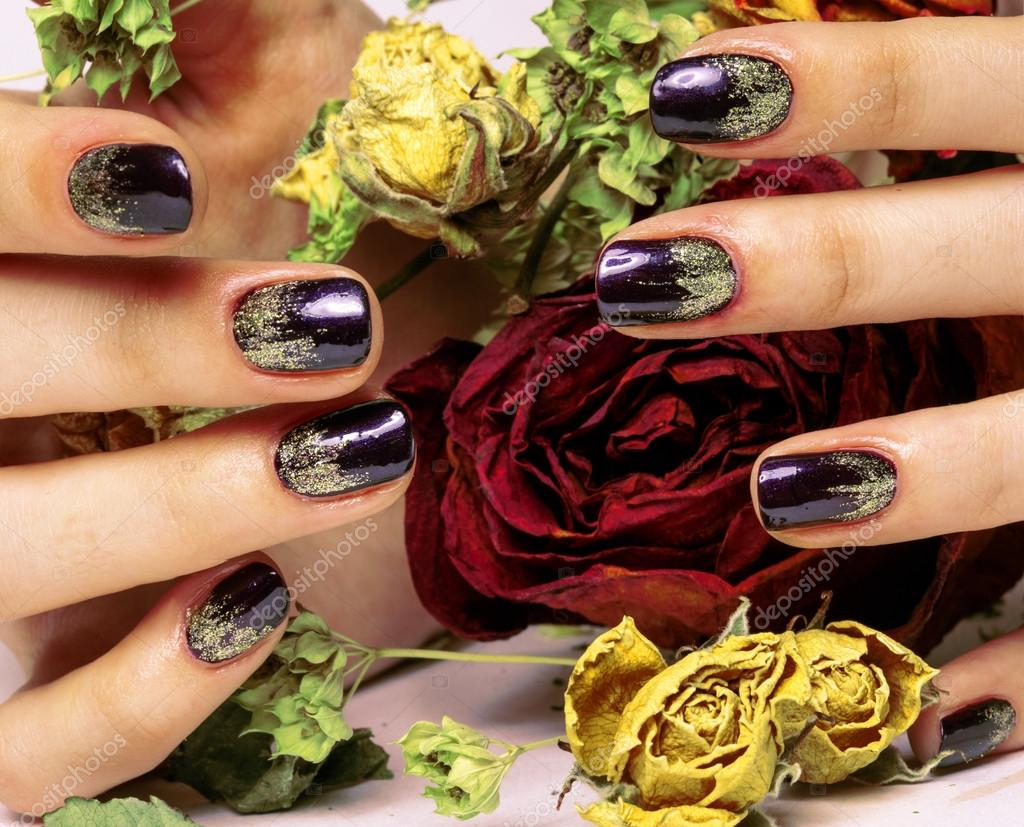 close up picture of manicure nails with dry flower red rose, deh