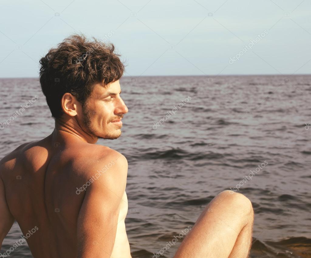 handsome young man at beach, hot vacations at lake close up