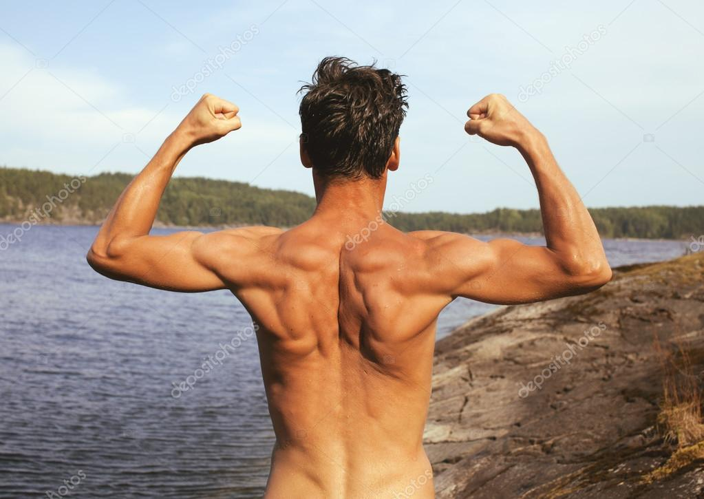 handsome young man at beach, hot vacations on lake close up, muscle from back warm