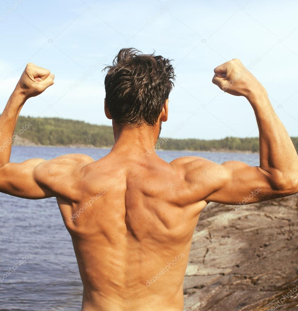 handsome young man at beach, hot vacations at lake close up, muscle from back