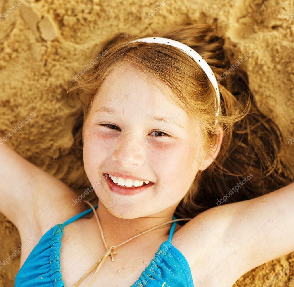 Little cute girl on sand having fun — Stock Photo © iordani