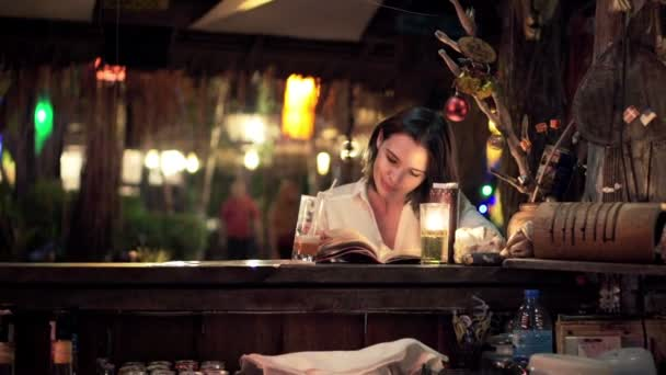 Image result for woman reading book in a bar
