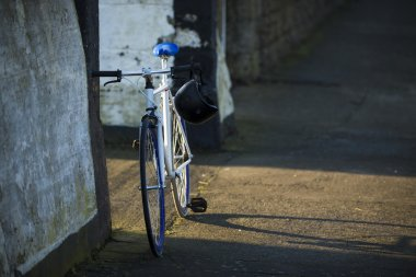 City bicycle fixed gear and concrete wall, vintage old retro bik