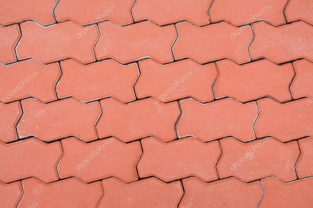 Red Paving Stones : Red brick paving stones on a sidewalk floor pattern