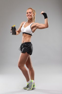 fitness girl drinking a sports drink