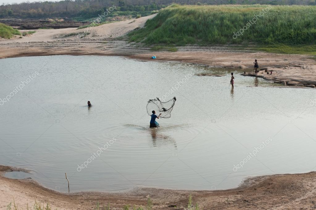 People fishing  at Mekong River. Thailand