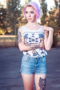 beautiful young girl with tattoos