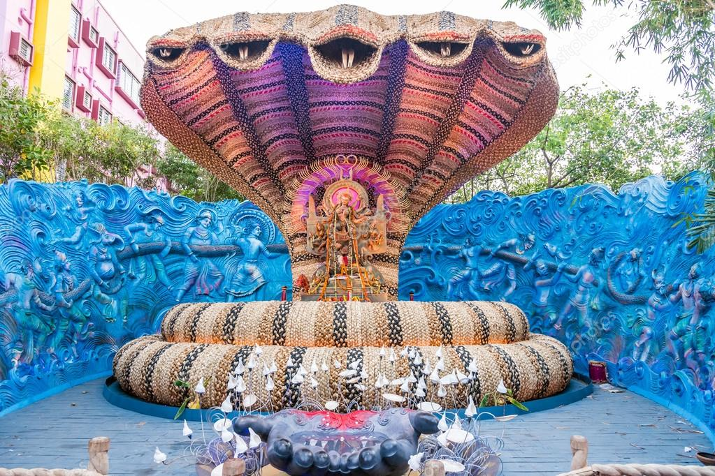 Beautiful durga idol in a snake shaped pandal stock photo beautiful durga idol in a snake shaped pandal at durga puja festival in kolkata west bengal india durga puja is the biggest religious festival of altavistaventures Gallery