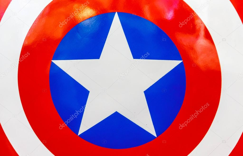 Logo of Captain America on shield.