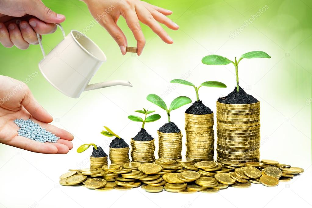 Cooperation - Hands helping planting trees growing on coins together with green background - Building business with csr and ethics