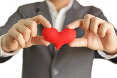 Businessman gives a red heart