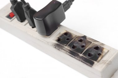 Burnt surge protector with adapters