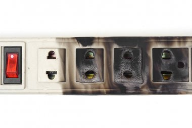 Burnt surge protector on white
