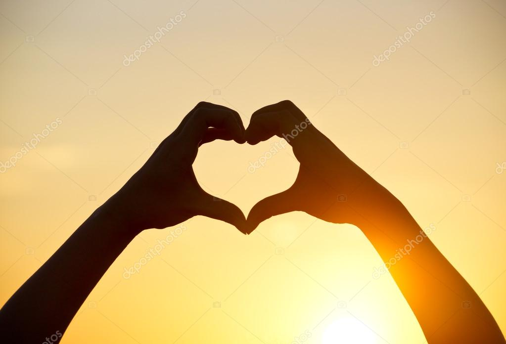 Heart symbol made with two hands — Stock Photo © weerapat