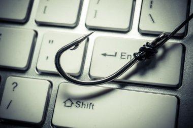 a fish hook on computer keyboard