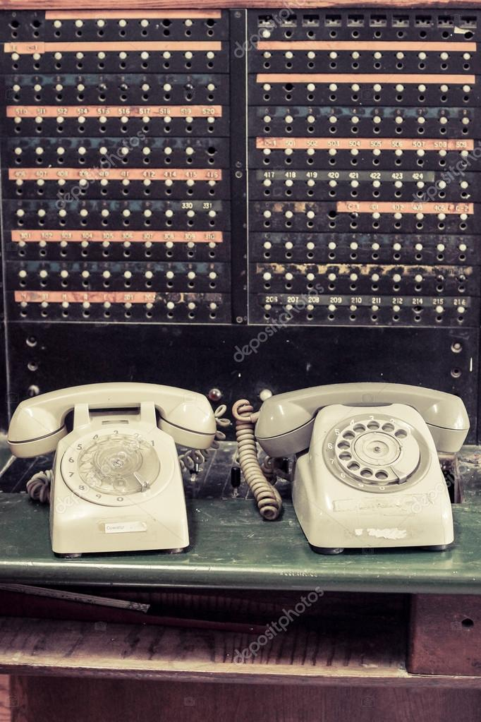 Old telephones with switchboard — Stock Photo © weerapat