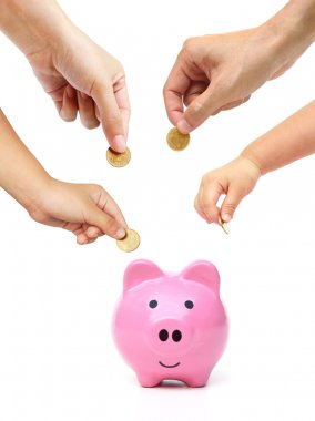 People in the family doing saving money in a pink piggybank