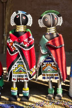 African unique traditional handmade colorful beads rag dolls. Local craft market in South Africa. Craftsmanship.