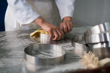 Pastry Chefs Hands Puling Pie Dough