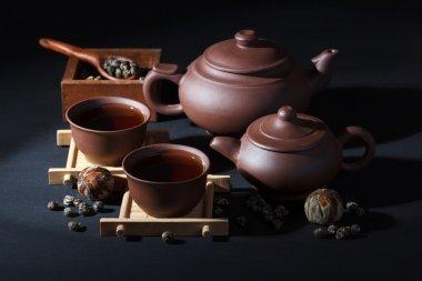 Ceramic tea set with green tea