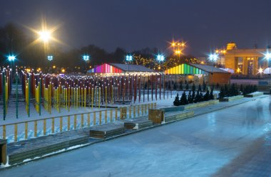 Beautiful decorated skating rink in Moscow park in the evening