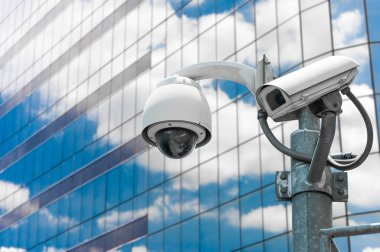 CCTV camera or surveillance operating with galss building in bac