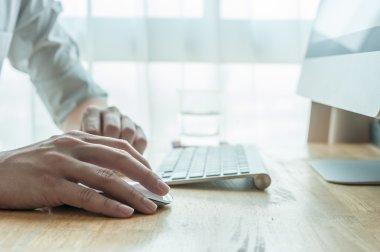 Man using desktop pc computer, mobile office concept