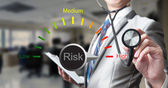 Fotografie Business man with stethoscope, risk management concept