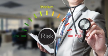 Business man with stethoscope, risk management concept