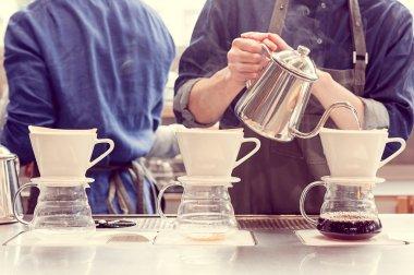 barista driping coffee