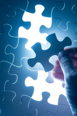 Hand insert jigsaw, conceptual image of business strategy, decis
