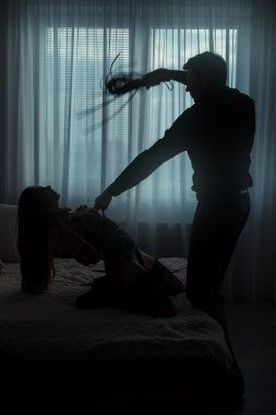 Man tied woman and beats.